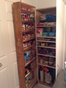 Pantry shown with store bought pantry.  My husband stained the rolling pantry to match our cabinets <3.